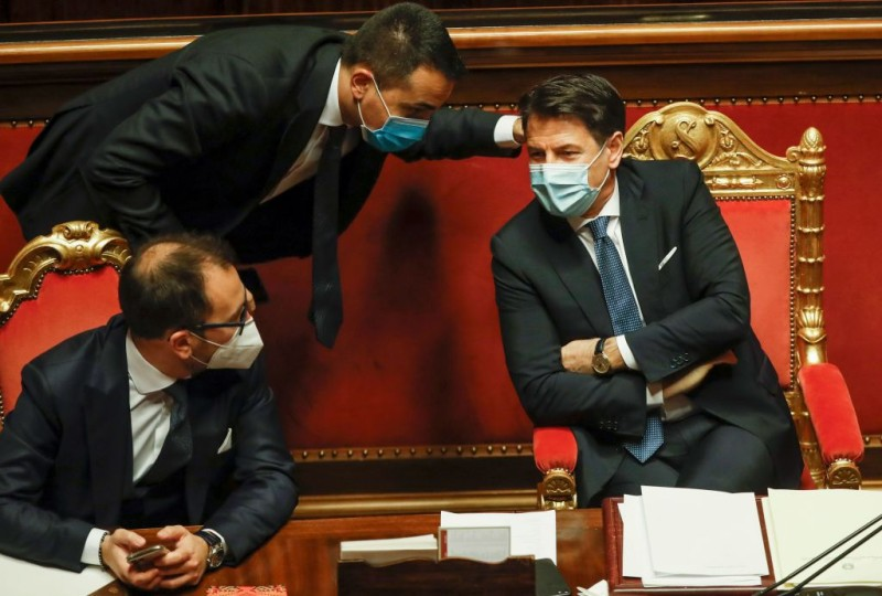 Italian Prime Minister Giuseppe Conte (right), Justice Minister Alfonso Bonafede (left), and Foreign Minister Luigi Di Maio talk during a debate prior to a confidence vote in Conte's government in the Senate at Palazzo Madama in Rome on Jan. 19.