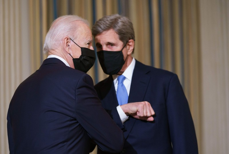 U.S. President Joe Biden greets Special Presidential Envoy for Climate John Kerry