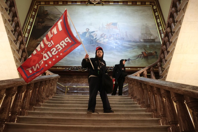 A protester holds a Trump flag inside the U.S. Capitol building near the Senate chamber in Washington on Jan. 6.