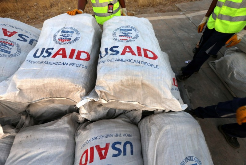 Airport personnel check humanitarian aid supplies from USAID