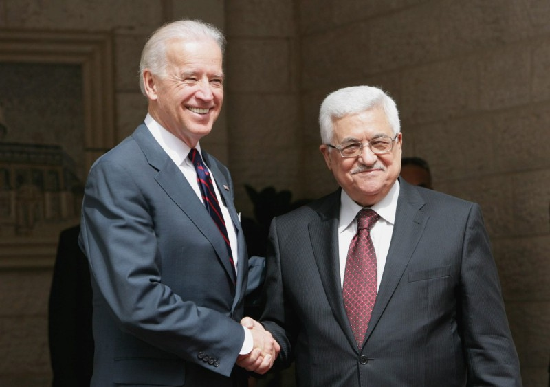 Palestinian President Mahmoud Abbas and U.S. Vice President Joe Biden shake hands prior to their meeting at the presidential compound in in Ramallah, West Bank, on March 10, 2010.