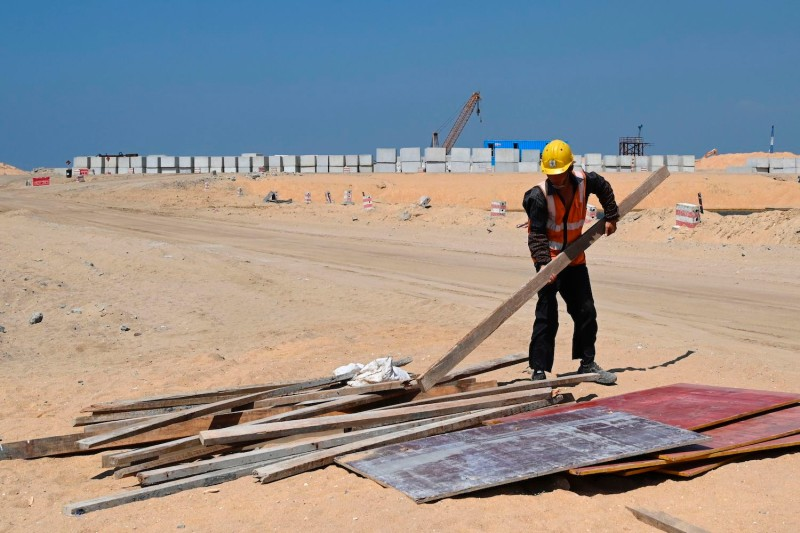 A Chinese laborer works at a construction site on reclaimed land, part of a Chinese-funded project for Port City, in Colombo, Sri Lanka, on Feb. 24, 2020.