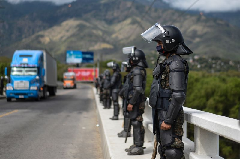 Members of the Guatemalan Army stand guard at a bridge after police and military officers turned away several groups of migrants who were part of a U.S.-bound caravan in Zacapa, Guatemala on Jan. 19.