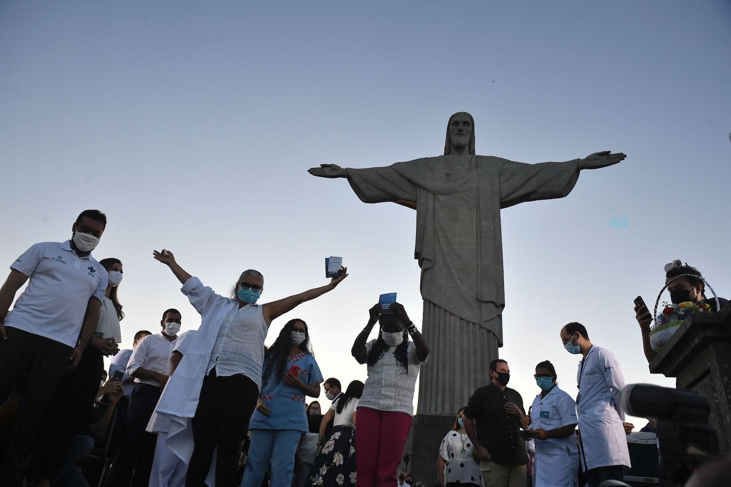 People show their vaccination cards after they were inoculated with the Sinovac Biotec's CoronaVac vaccine against COVID-19 at the Christ The Redeemer statue in Rio de Janeiro, Brazil on Jan. 18.