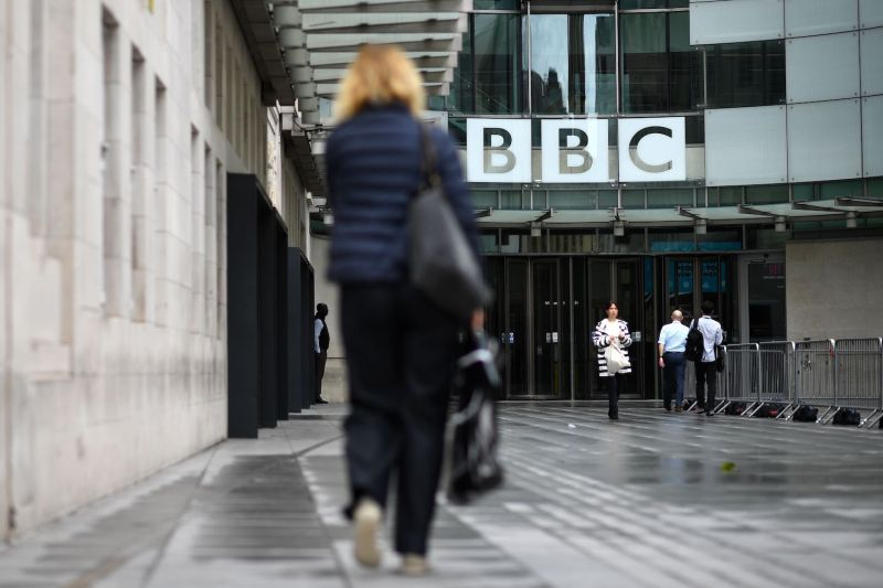 People walk outside the BBC headquarters in Portland Place, London on July 2, 2020.