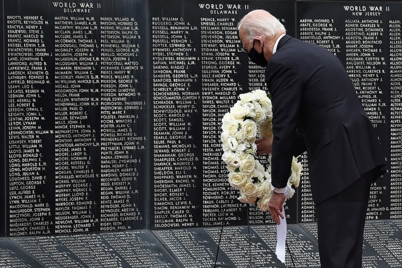 As a presidential candidate, Joe Biden pays his respects to fallen service members on Memorial Day at Delaware Memorial Bridge Veteran's Memorial Park in New Castle, Delaware, on May 25, 2020.