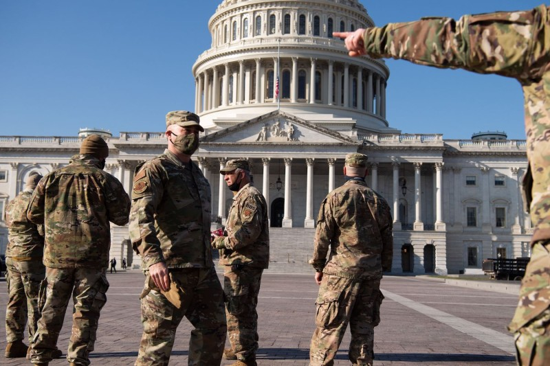 Members of the National Guard patrol outside of the U.S. Capitol in Washington, DC on Jan 12.
