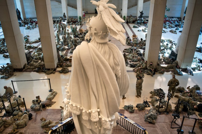 Members of the National Guard rest in the Capitol Visitor's Center on Capitol Hill in Washington, DC on Jan 13.