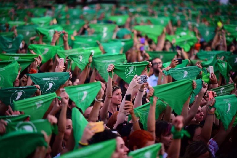 Thousands of women hold green scarves demanding the decriminalization of abortion in Buenos Aires on Feb. 19, 2020.