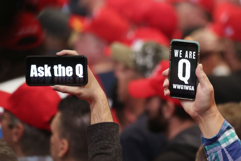 Supporters of President Donald Trump hold up their phones with messages referring to the QAnon conspiracy theory at a campaign rally at Las Vegas Convention Center on Feb 21, 2020.