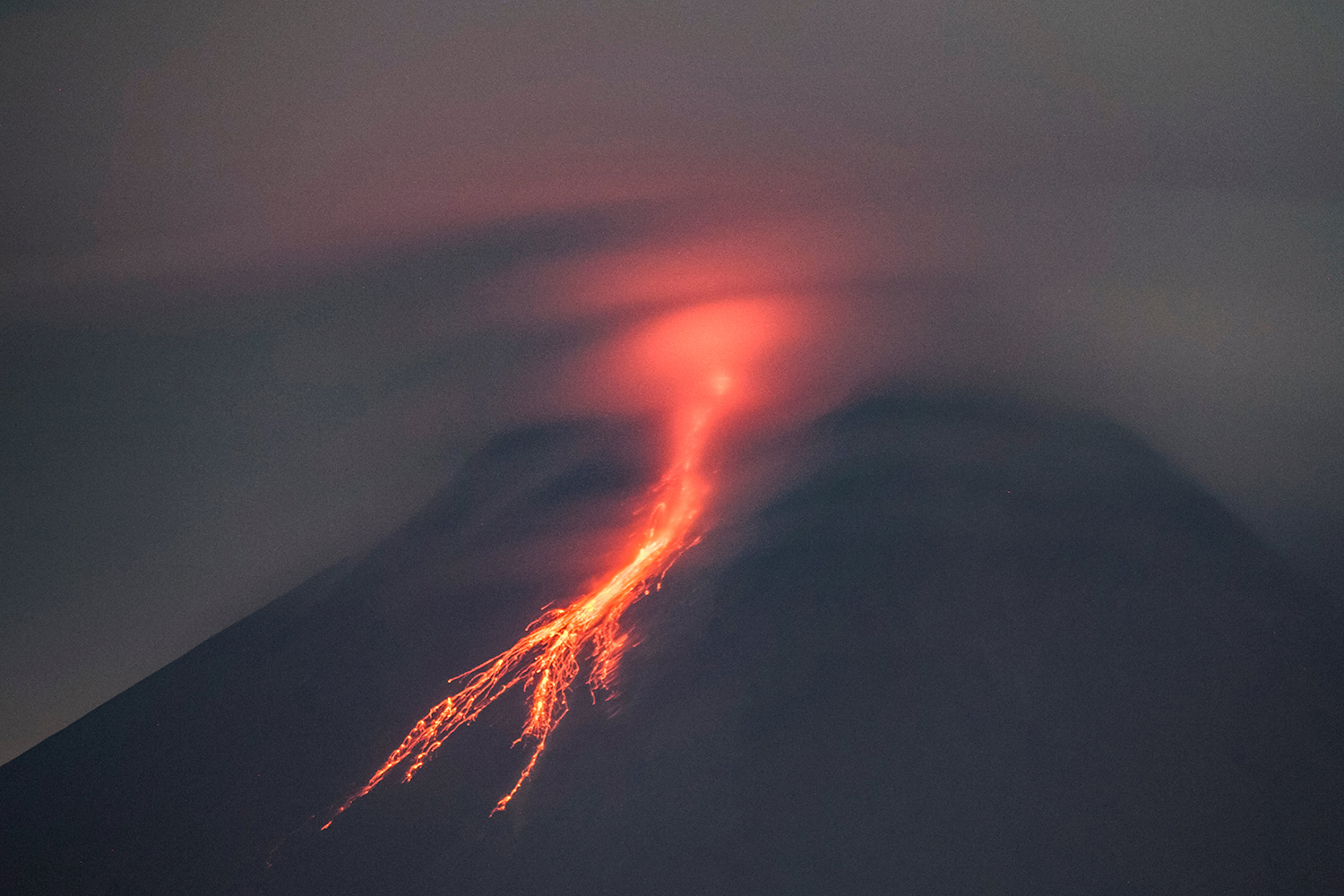 Lava flows from Mount Merapi as seen from Yogyakarta, Indonesia, on Jan. 19. AGUNG SUPRIYANTO/AFP via Getty Images