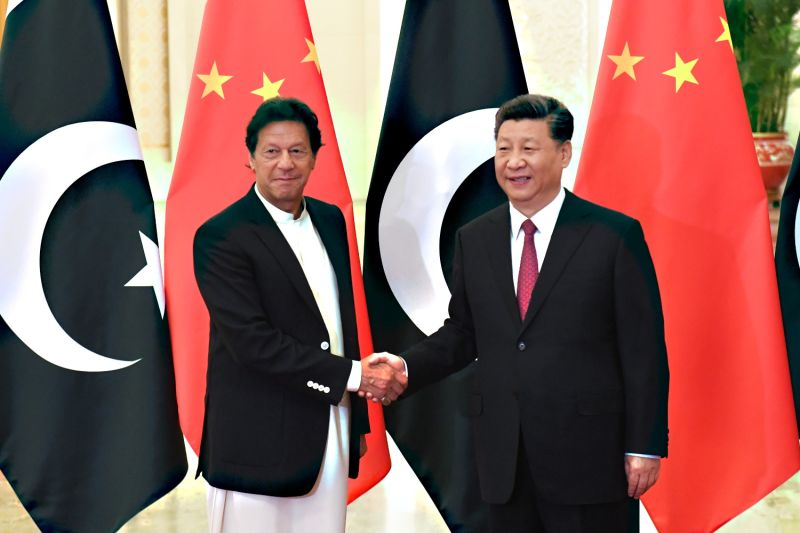 China's President Xi Jinping, right, shakes hands with Pakistan's Prime Minister Imran Khan