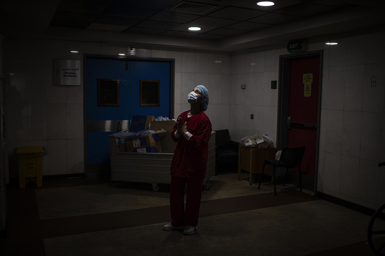 A Lebanese nurse prays inside the corridors of the ICU at Rafik Hariri University Hospital in Beirut on Jan. 15. Diego Ibarra Sanchez/Getty Images