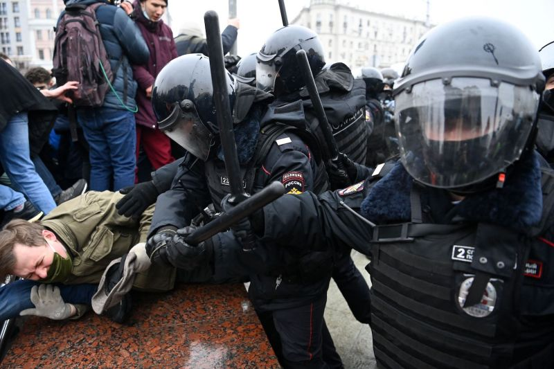 Protesters clash with riot police during a rally in support of jailed Russian opposition leader Alexei Navalny