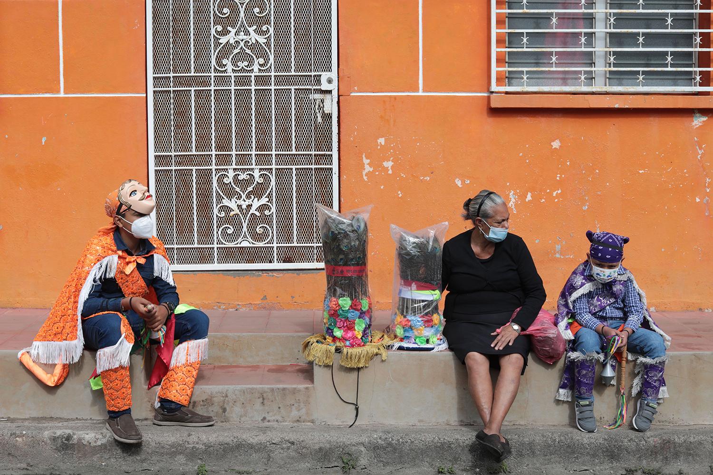 Dancers prepare to perform during Saint Sebastian festivities in Diriamba, Nicaragua, on Jan. 19. INTI OCON/AFP via Getty Images