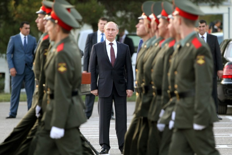 Russian President Vladimir Putin attends a welcome ceremony at the Russian military base in Dushanbe, Tajikistan, on Oct. 5, 2012.