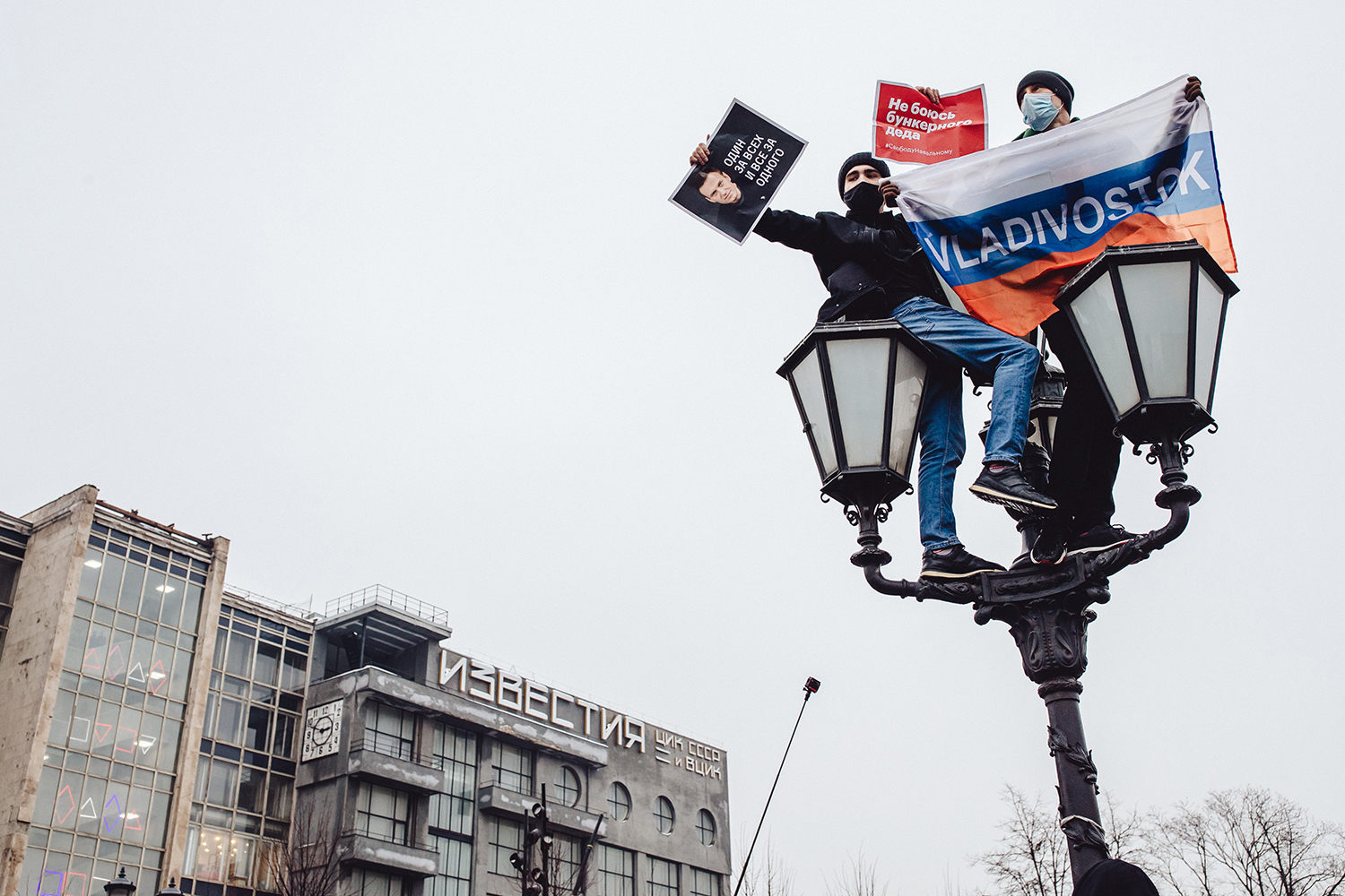 Protesters hold banners at the top of a lamppost at Pushkin Square in Moscow on Jan. 23. Earlier in the week, Kremlin-critic Alexei Navalny called for supporters to protest his arrest and pre-trial detention, which came one day after his return to Russia following his poisoning with a nerve agent last summer. Getty Images