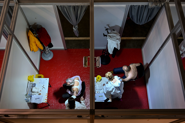 Men receive a COVID-19 vaccine in Belgrade, Serbia, on Jan. 25. ANDREJ ISAKOVIC/AFP via Getty Images