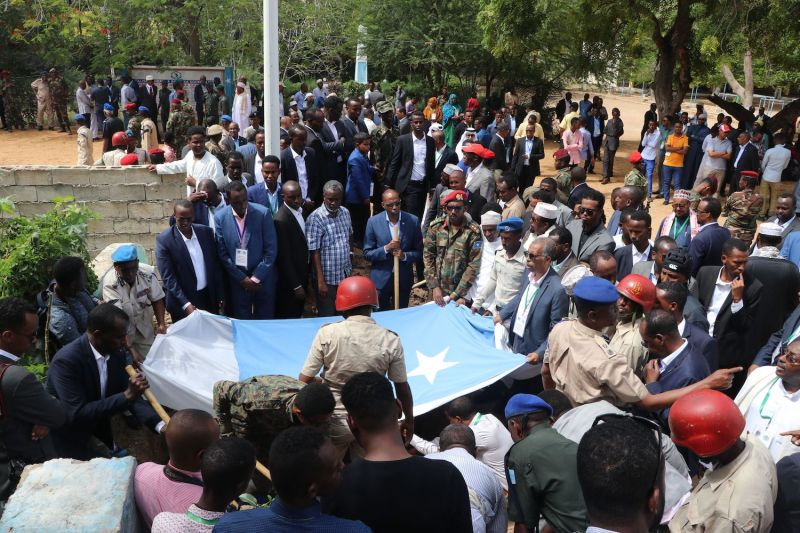 People attend the funeral ceremony of Mogadishu Mayor Abdirahman Omar Osman, who died a week after being seriously wounded in an al-Shabab suicide attack at his office, in Mogadishu on Aug. 4, 2019.