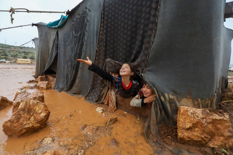 Children play in the Umm Jurn camp for the displaced, near the village of Kafr Uruq, in Syria's northern rebel-held Idlib province on Jan. 17. DULAZIZ KETAZ/AFP via Getty Images