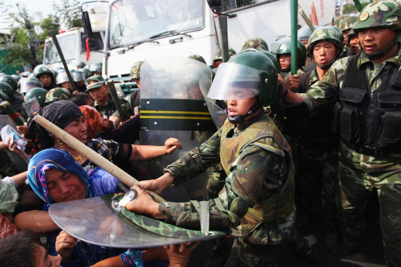 Chinese police assault Uighur women protesting