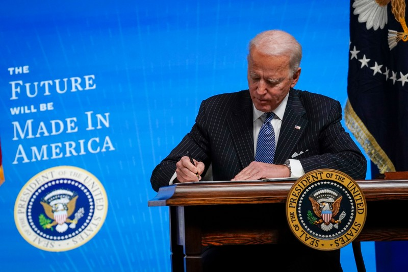 U.S. President Joe Biden signs an executive order related to U.S. manufacturing at the White House in Washington on Jan. 25.