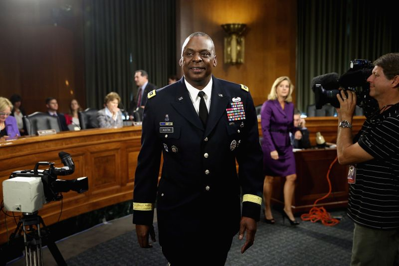 Gen. Lloyd Austin prepares to testify before the U.S. Senate Armed Services Committee in the Dirksen Senate Office Building in Washington, DC, on Sept. 16, 2015.