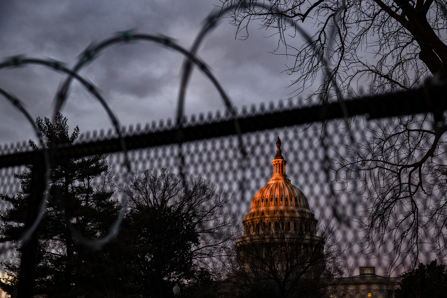 Razor wire tops the fence surrounding the U.S. Capitol in Washington as the sun rises on Jan. 17.