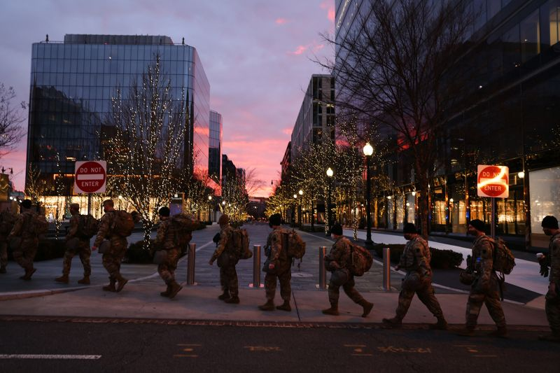 Members of the U.S. National Guard walk the largely empty streets of Washington on Jan. 17.