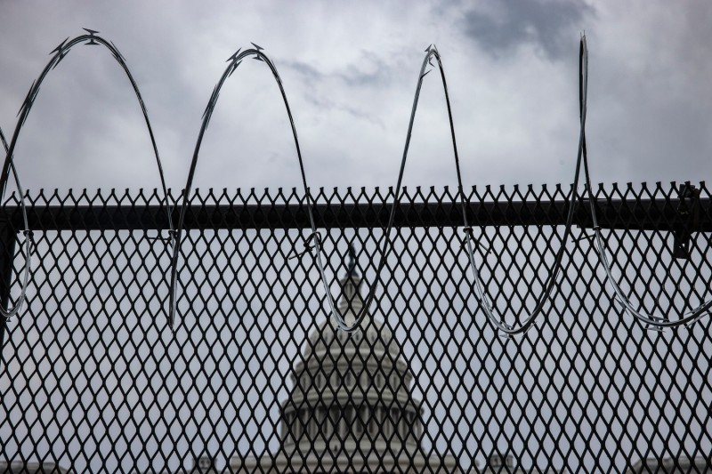 A view of the U.S. Capitol Dome behind freshly-installed razor wire-tipped fencing on January 15, 2021 in Washington, D.C.