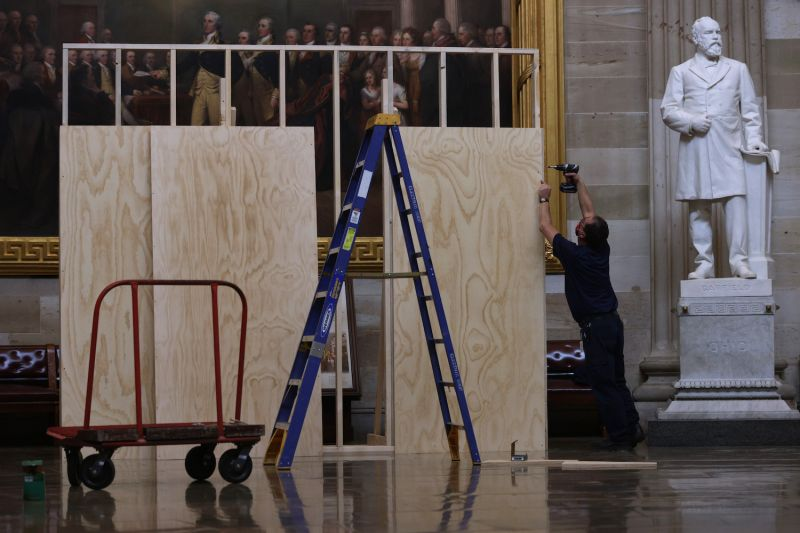 A worker builds a wooden structure, part of the preparation for the presidential inauguration, at the Rotunda of the U.S. Capitol on Jan. 8 in Washington.