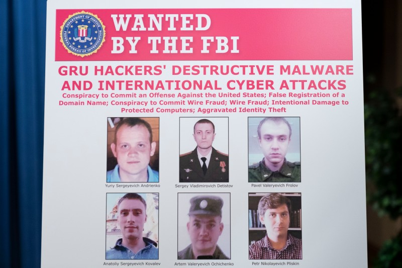 A poster showing six wanted Russian military intelligence officers is displayed at the U.S. Department of Justice in Washington on Oct. 19, 2020.