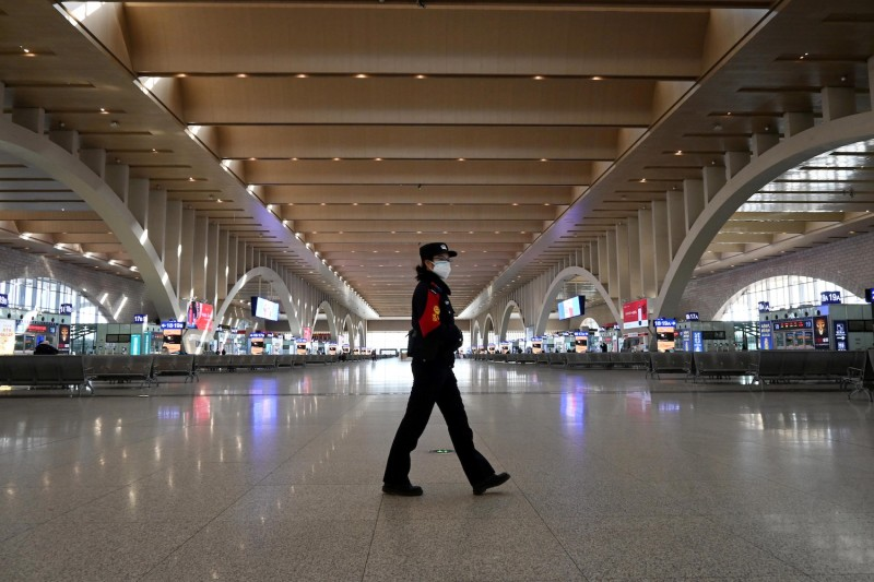 A police patrol walks in an empty railway station on Jan. 7 in Shijiazhuang, China.