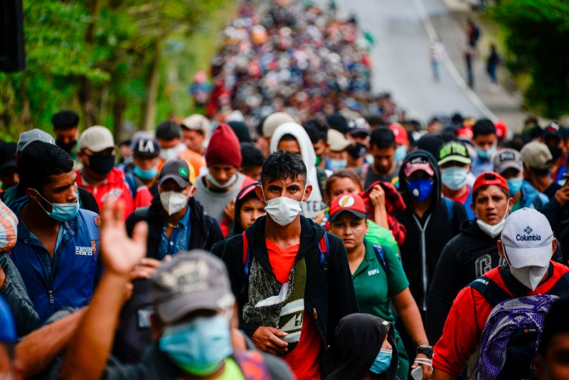 Honduran migrants, en route to the border with the United States, walk along a road in Camotan, Guatemala, on Jan. 16.