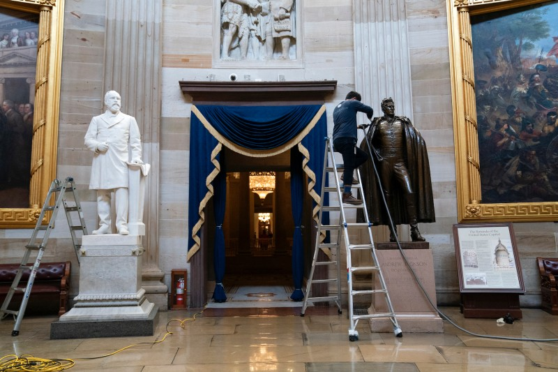A worker cleans the statue of former President Andrew Jackson in the rotunda of the U.S. Capitol on January 12, 2021 in Washington, D.C.