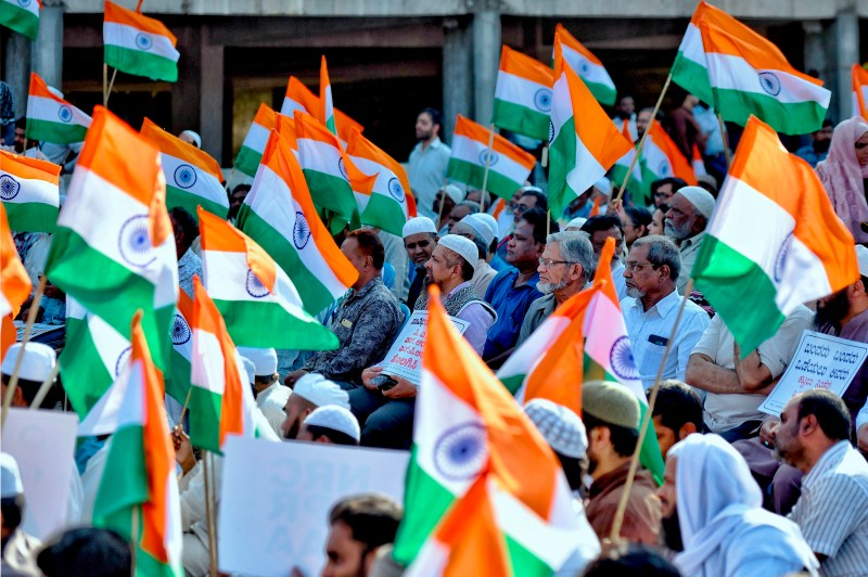 Indian Muslims carry Indian flags during a protest against a new citizenship law, in Bengaluru on Jan. 20, 2020.