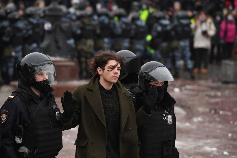 Police detain a protester during a rally in support of jailed opposition leader Alexey Navalny in Moscow on Jan. 23.