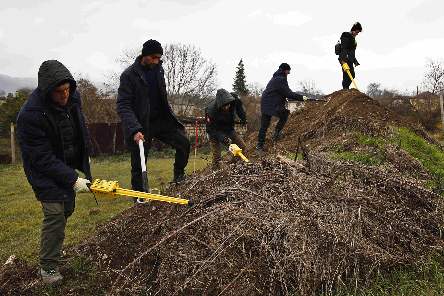 Deminers working for the HALO Trust sweep for unexploded munitions scattered throughout the village of Aygestan in Nagorno Karabakh on Dec. 3, 2020.