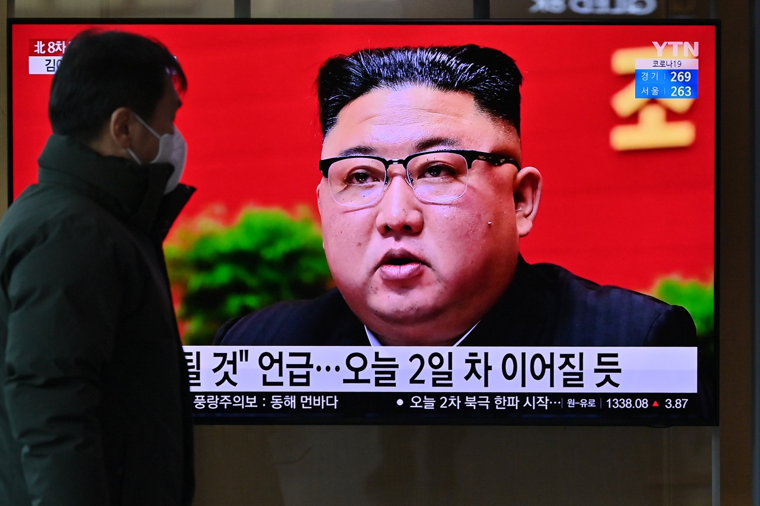 A man watches a television screen showing news footage of North Korean leader Kim Jong Un attending the 8th Congress of the ruling Workers' Party, held in Pyongyang, at a railway station in Seoul on Jan. 6.