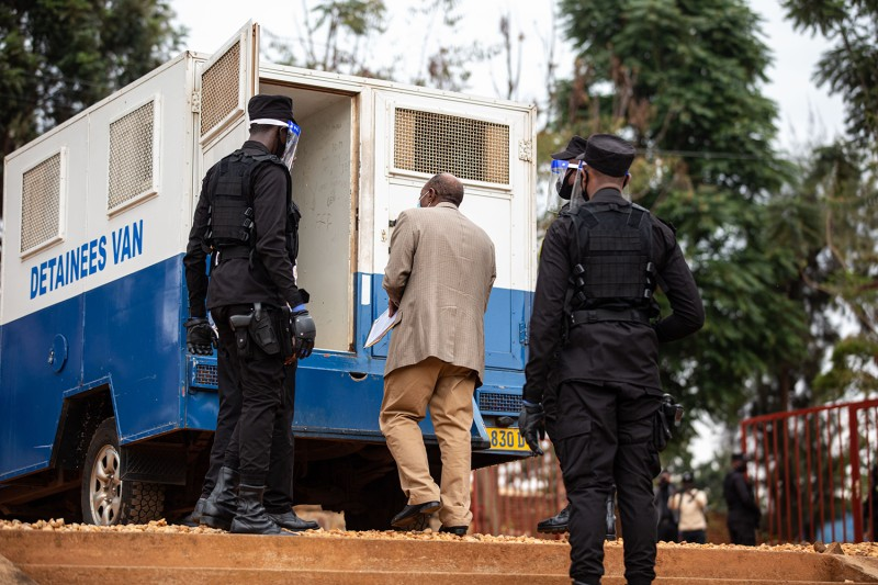 Paul Rusesabagina is escorted by police officers after his pretrial court session at the Kicukiro Primary Court in Kigali, Rwanda, on Sept. 14, 2020.