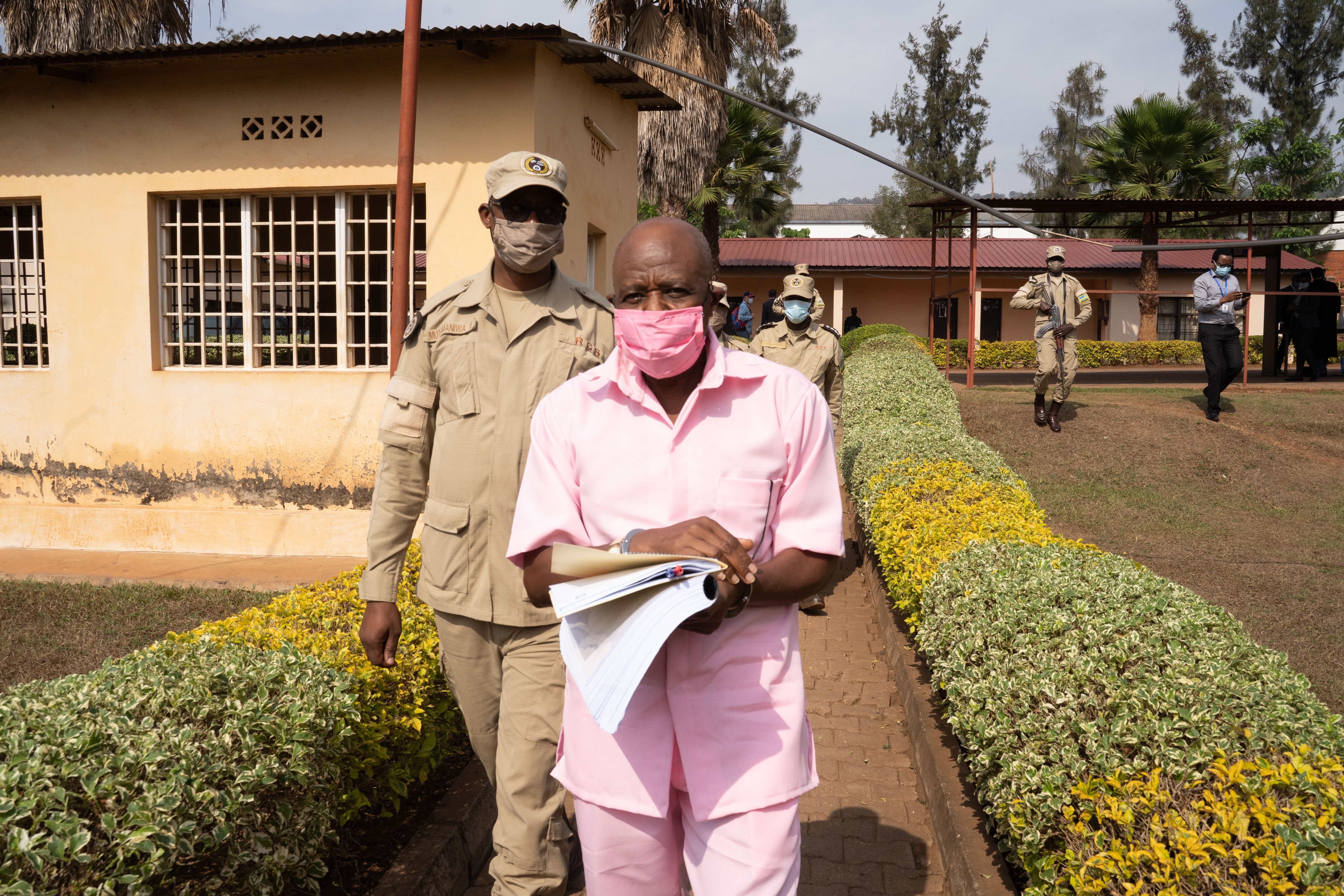 Rusesabagina arrives from the Nyarugenge prison with Rwanda Correctional Service officers at the Nyarugenge Court of Justice in Kigali on Sept. 25, 2020.