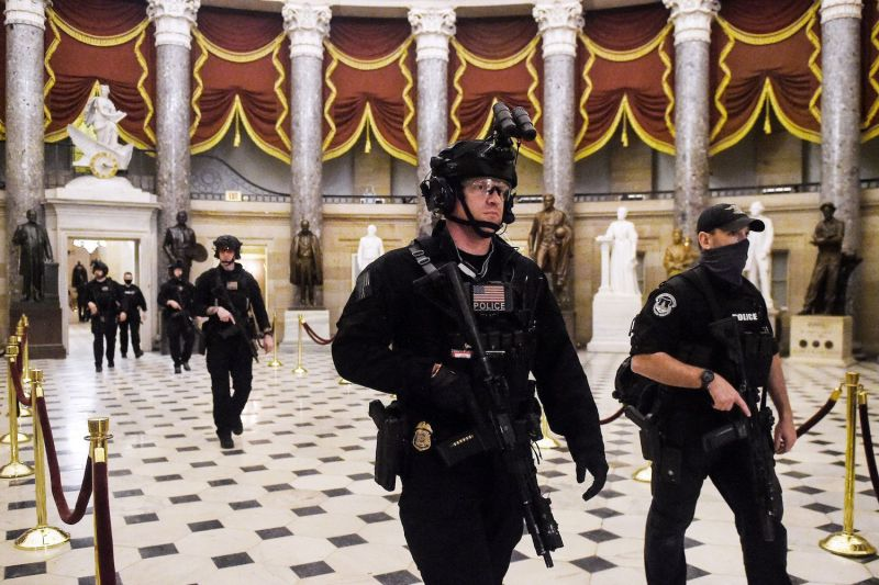 Members of the Swat team patrol and secure the Statuary Hall before U.S. Vice President makes his way into the House Chamber, at the U.S. Capitol, on the morning of Jan. 7 hours after a mob invaded the building.