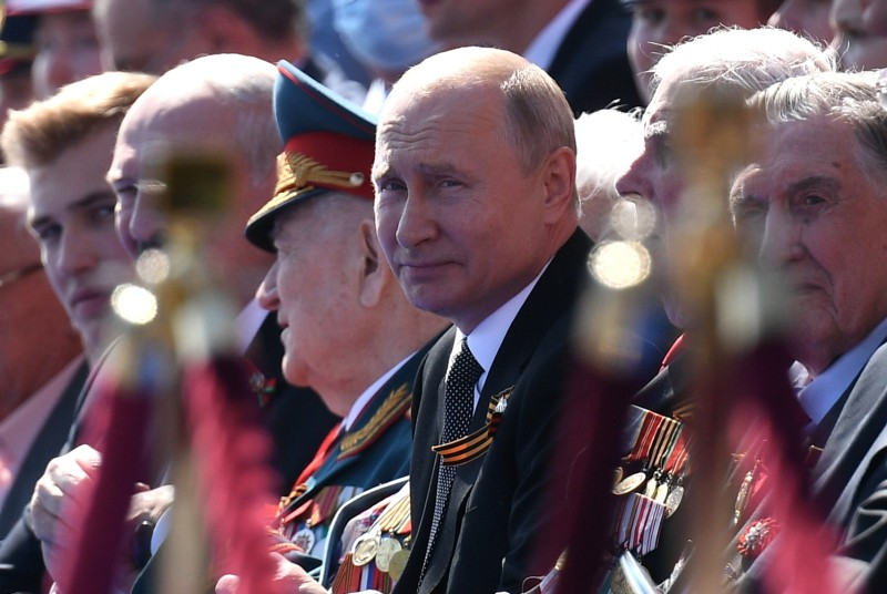Russian President Vladimir Putin watches a military parade on Red Square in Moscow on June 24, 2020.
