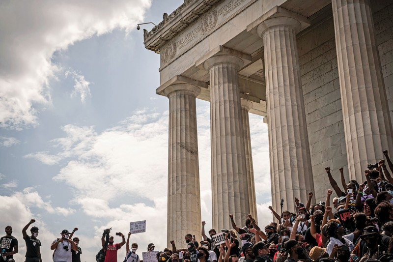 Thousands of people gather at the Lincoln Memorial in Washington to call for police and criminal justice reforms.