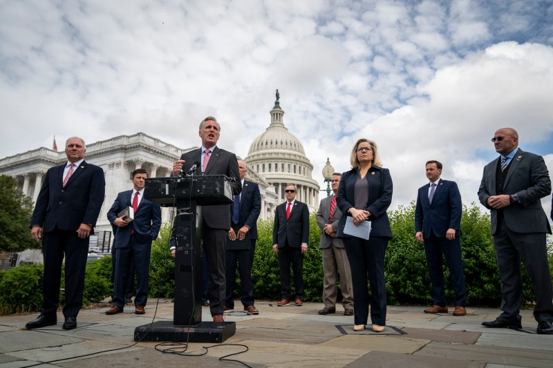 Surrounded by fellow House Republican members, House Minority Leader Kevin McCarthy speaks during a news conference outside the U.S. Capitol on May 27 in Washington.