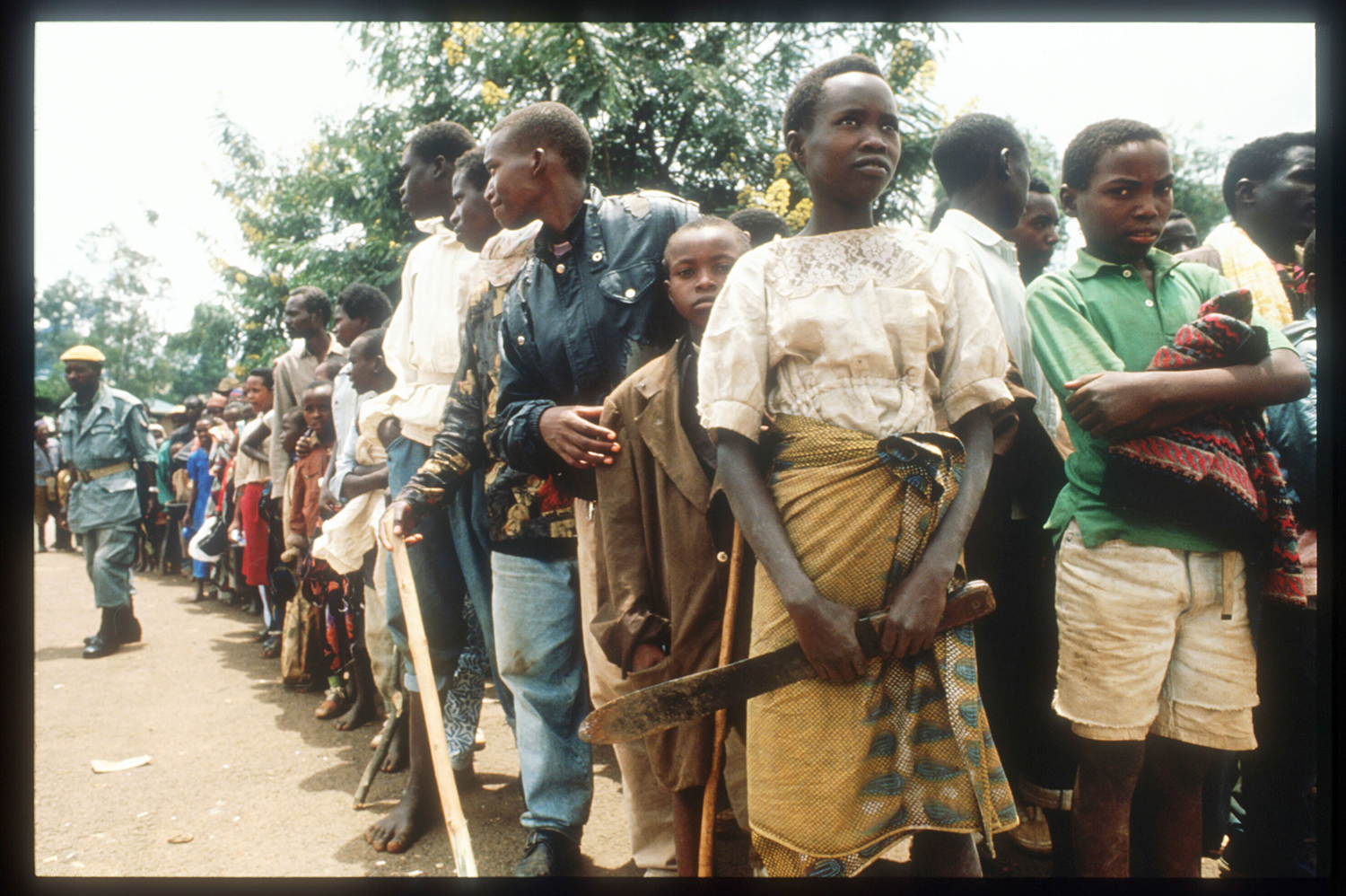 Armed civilians wait for Red Cross-delivered food in Kigali, Rwanda, on April 13, 1994. Scott Peterson/Liaison