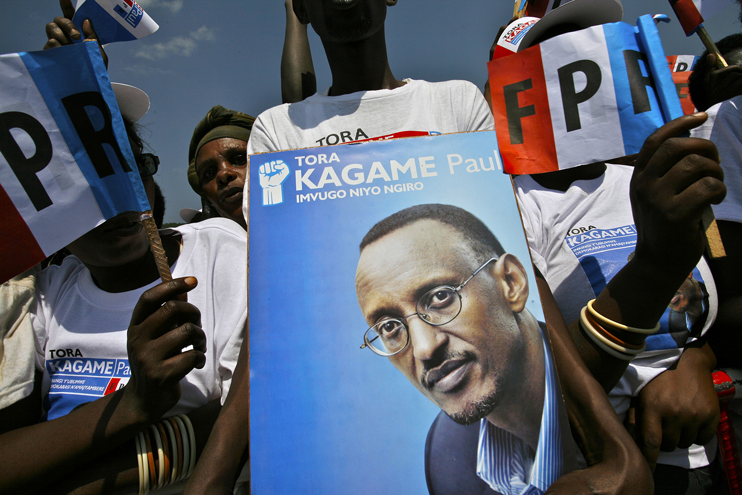 Supporters hold up posters while attending a Rwandan Patriotic Front political rally in Kigali, Rwanda, for the reelection of the President Paul Kagame on Aug. 3, 2010.