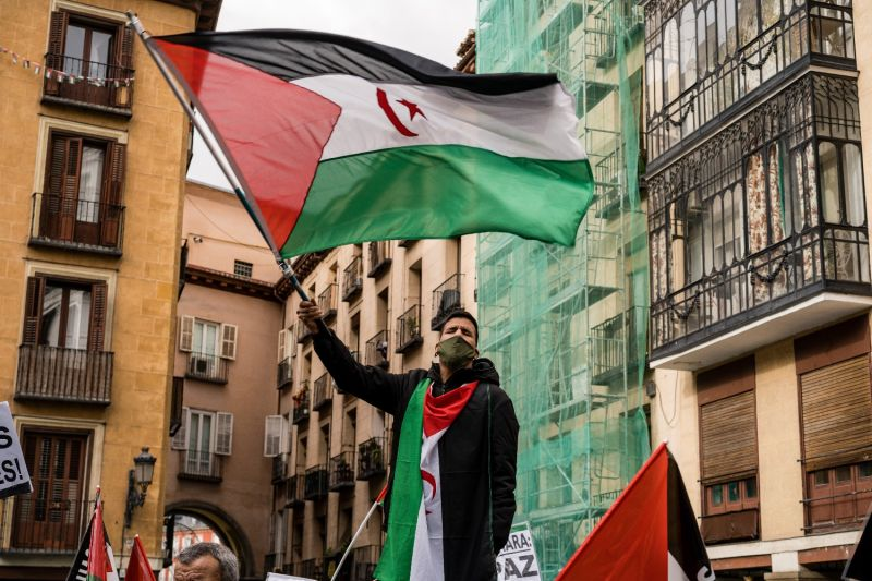 A protester waves the Sahrawi flag in front of the Spanish Ministry of Foreign Affairs in Madrid on Dec. 10, 2020.