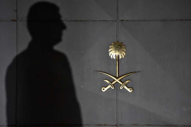 Security officials wait in front of the gate door of the Saudi Arabian consulate on October 17, 2018 in Istanbul, Turkey two weeks after Jamal Khashoggi was assassinated inside the building.