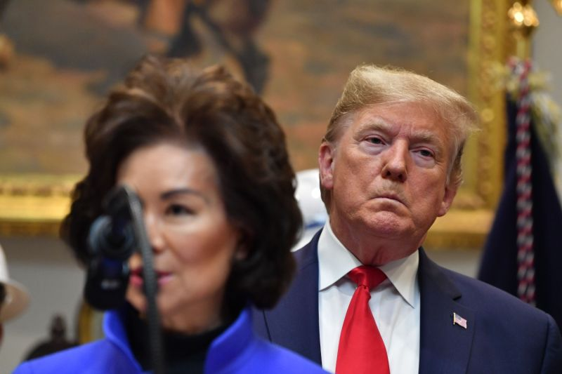 U.S. President Donald Trump watches as former U.S. Secretary of Transportation Elaine Chao speaks at the White House in Washington, DC, on Jan. 9, 2020.